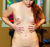 This naughty redhead with a unshaven pussy just loves to exercise naked.