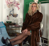 Busty blonde chick in stockings and mink coat exposing her big juggs