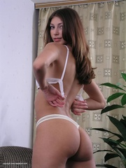 lovely brunette freshie undresses