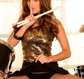 A girl who plays the drums needs to relax as she pleasures herself.