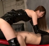 Very hot Japanese mistress in latex clothes sitting on the face of her