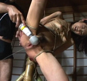 Bound and suspended Asian slut tortured with hot wax and enema