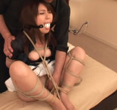 Hot Asian babe with a gag-ball getting hogtied tightly