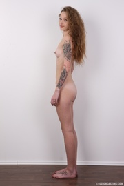 young tattooed cute seductress