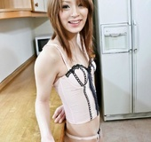 Red Asian teeny in a pink corset gets her shaved snatch satisfied with