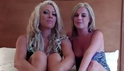 two sexy blondes laugh