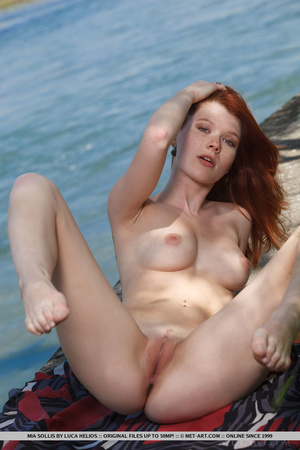 Young redhead takes off her bikini on th - XXX Dessert - Picture 12