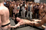 crowd watches tied stud