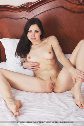beautiful young brunette sensuously