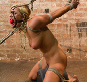 Blonde with hairy cunt tied and hung upside down dominated and screwed