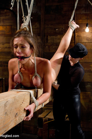 Slim sexy babe roped to wood with tits t - XXX Dessert - Picture 2