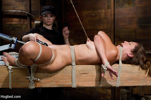 Slim sexy babe roped to wood with tits t - XXX Dessert - Picture 12