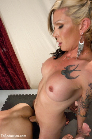 Colorful tattooed shemale gets guy to su - XXX Dessert - Picture 9