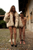 Tranny in mink coat takes male slave indoors for cock sucking and to fuck
