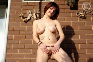 Cute nude chick by brick wall shows off  - XXX Dessert - Picture 7