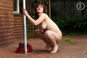 Cute nude chick by brick wall shows off  - XXX Dessert - Picture 12