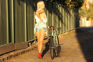 Blonde on bike gives a peep of sexy smal - XXX Dessert - Picture 13