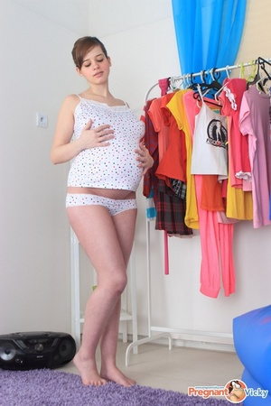 Pregnant naughty chick trying out clothes takes time to fuck herself with dildo - XXXonXXX - Pic 4