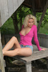 Sexy blonde in hot short jeans shorts and pink top strips to reveal sexy