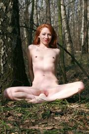 seductive nude redhead looking