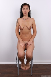 black haired lady strips