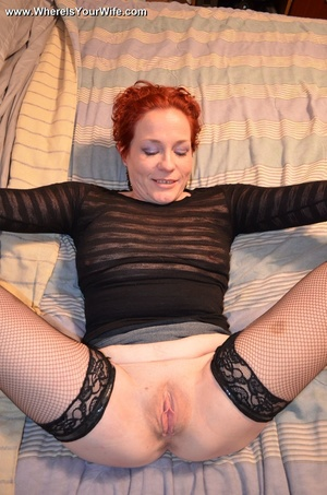 Busty mature redhead in fishnets stockin - Picture 6