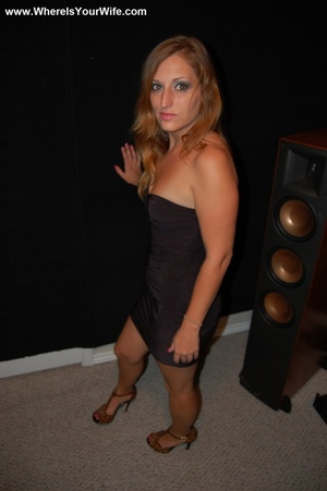 Blonde MILF in a black dress exposing he - XXX Dessert - Picture 1