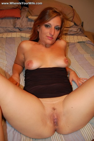 Blonde MILF in a black dress exposing he - XXX Dessert - Picture 12