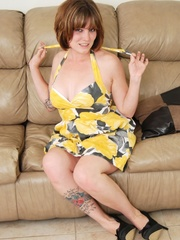 Creamy babe in hot yellow dress strips erotically on - Picture 1