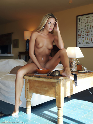 slim blonde navel piercing