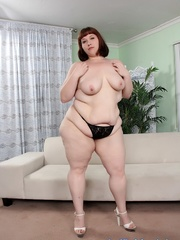 Redhead with fatty folds and in black lingerie takes it - Picture 4