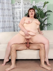 Naked BBW with red hair takes a cock on the sofa. - Picture 2