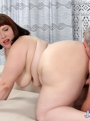 Naked BBW with red hair takes a cock on the sofa. - Picture 10