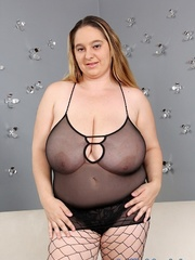 Plump dame in black lingerie and fishnets stripping and - Picture 1