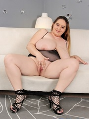 Plump dame in black lingerie and fishnets stripping and - Picture 9