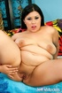 Asian BBW in pigtails and black lingerie gets naked and spreads slit.