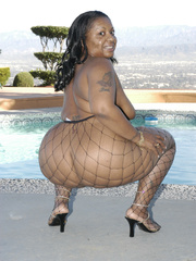 Hefty black honey, Carmyell, shows off poolside and and - Picture 5