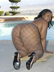 Hefty black honey, Carmyell, shows off poolside and and - Picture 6