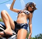 Love doll in a shirt, denim shorts and checkered bikini strips and washes