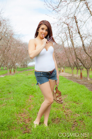 Young tattooed brunette in the orchard   - XXX Dessert - Picture 2