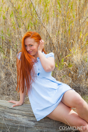 Redhead in the woods unbuttons dress, re - XXX Dessert - Picture 2