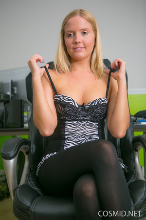 Young blondie on a chair pulls dress dow - XXX Dessert - Picture 2