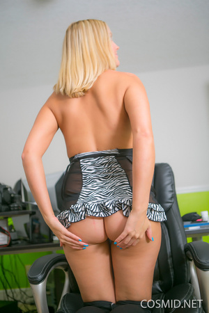 Young blondie on a chair pulls dress dow - XXX Dessert - Picture 9