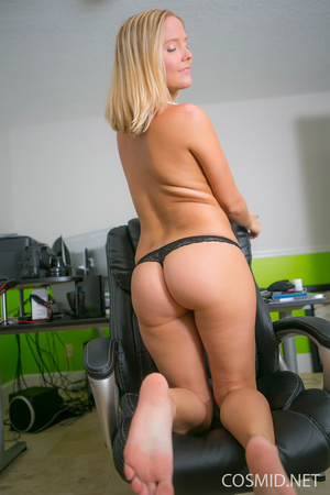 Young blondie on a chair pulls dress dow - XXX Dessert - Picture 14