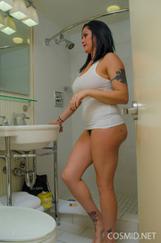 tattooed woman showers with