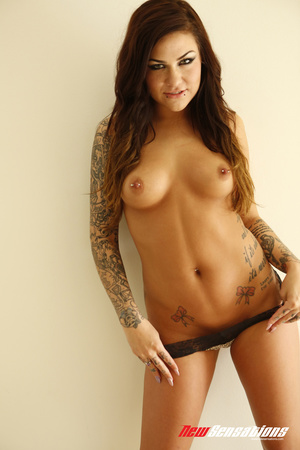 Tattooed brunette twists and turns on th - Picture 2