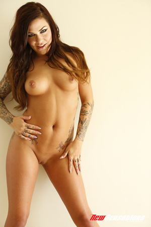 Tattooed brunette twists and turns on th - Picture 5