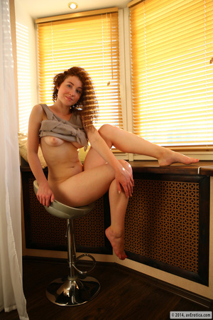 Fun minx in a grey shirt and green panties poses by the window. - XXXonXXX - Pic 10