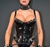 Cool femdom scene from ponytailed brunette mistress in a latex body with