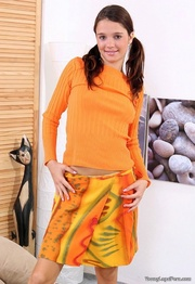 brunette orange top skirt